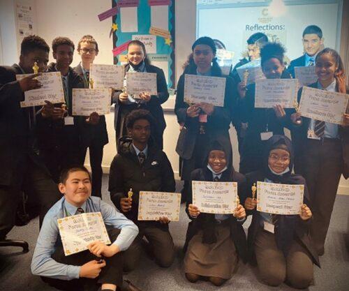 Children holding up certificates
